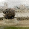 through rainy steamed up window, abstract strre scene